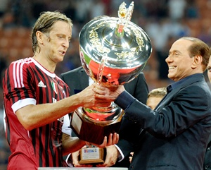 AC Milan chairman Silvio Berlusconi and Massimo Ambrosini celebrate