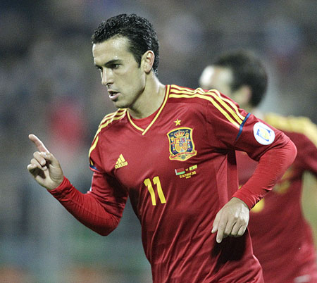 Spain's Pedro celebrates after scoring against Belarus
