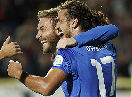 Italy's Pablo Osvaldo (right) celebrates with teammate Daniele De Rossi after scoring a goal against Armenia