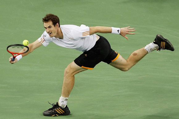 Andy Murray of Great Britain returns a shot to Radek Stepanek of the Czech Republic during the quarter-finals of the Shanghai Masters on Friday