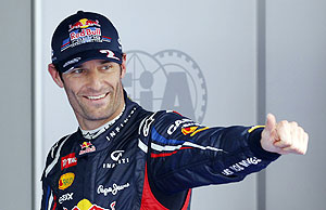Red Bull Formula One driver Mark Webber celebrates taking pole position after the qualifying session of the South Korean Grand Prix at the Korea International Circuit in Yeongam on Saturday