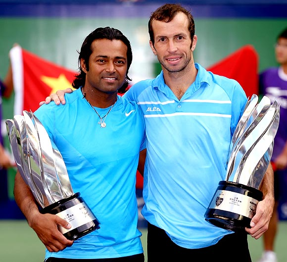 Leander Paes and Radek Stepanek pose after winning the Shanghai Masters title