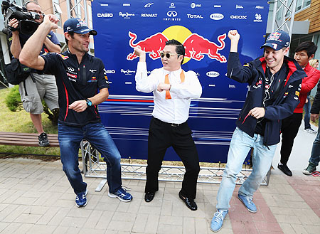 South Korean pop sensation Psy doing the Gangnam Style dance with Red Bull's Mark Webber and Sebastian Vettel