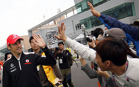 McLaren Formula One driver Jenson Button (left) greets fans before an autograph signing session at the Korea International Circuit  in Yeongam