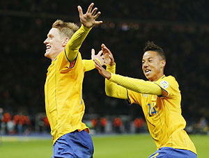 Sweden's Rasmus Elm celebrates with his teammate Tobias Sana (right) after scoring against Germany during the World Cup qualifier in Berlin on Tuesday