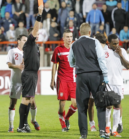 Referee Huseyin Gocek shows the red card to Danny Rose (right) of England