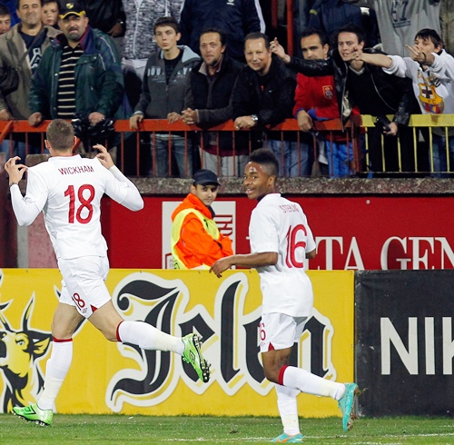 Connor Wickham (left) of England celebrates his goal with teammate Raheem Sterling