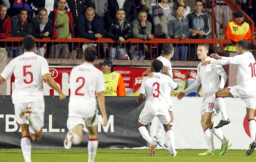 Connor Wickham (left) of England celebrates with teammates