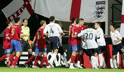 England and Serbia players during a scuffle