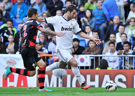 Gonzalo Higuain of Real Madrid scores against Celta Vigo