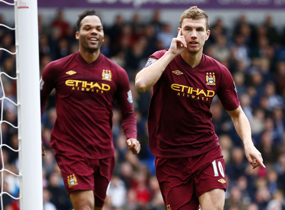 Manchester City's Edin Dzeko celebrates his goal against West Bromwich Albion during their English Premier League match at The Hawthorns