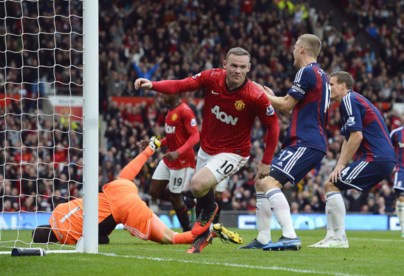 Manchester United's Wayne Rooney (C) celebrates scoring against Stoke City during their English Premier League match