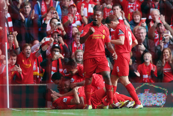 Raheem Sterling of Liverpool celebrates with his team-mates after scoring against Reading at Anfield