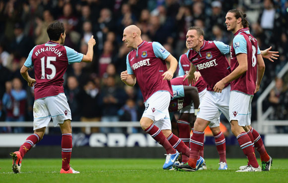Kevin Nolan of West Ham (2nd right) celebrates with team mate Yossi Benayoun after scoring against Southampton at Boleyn Ground
