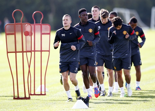 Manchester United's Tom Cleverley (left) runs during a training session