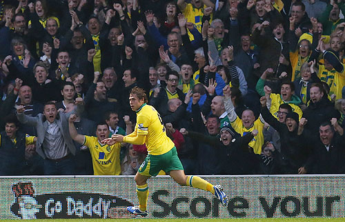 Grant Holt of Norwich City celebrates scoring against Arsenal
