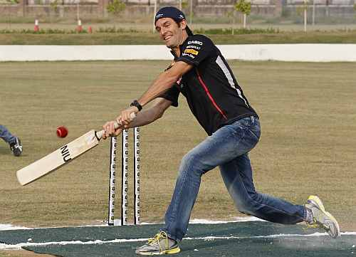 Red Bull Formula One driver Mark Webber plays cricket with India's Gautam Gambhir