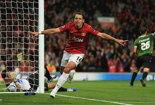 Javier Hernandez of Manchester United celebrates scoring his team's third goal to make the score 3-2 during the UEFA Champions League Group H match between Manchester United and SC Braga