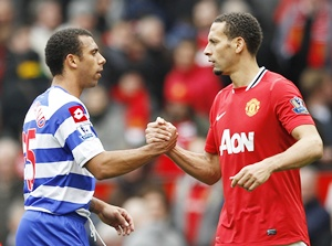 Manchester United's Rio Ferdinand (right) shakes hands with brotherAnton