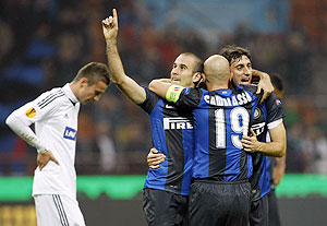 Inter Milan's Rodrigo Palacio (2nd from left) celebrates with his teammates Esteban Cambiasso (centre) and Diego Milito after scoring against Partizan Belgrade during their Europa League match on Thursday