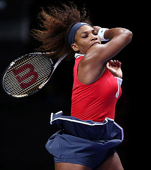 Serena Williams of USA plays a forehand in her match against Victoria Azarenka of Belarus