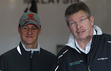 Mercedes GP Team Principal Ross Brawn and driver Michael Schumacher