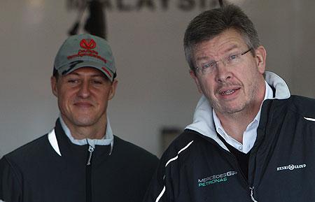 Mercedes GP Team Principal Ross Brawn and driver Michael Schumacher