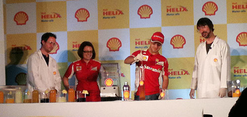 Ferrari's Felipe Massa (centre) prepares a cocktail drink at a press event on Thursday