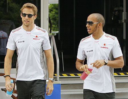 McLaren's Jenson Button (left) with teammate Lewis Hamilton