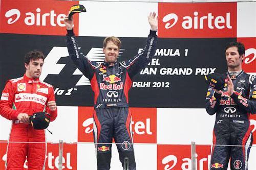 Fernando Alonso of Ferrari, Sebastian Vettel of Red Bull   Racing and Mark Webber Red Bull celebrate on the podium