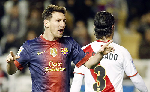 Barcelona's Lionel Messi celebrates after scoring against Rayo Vallecano
