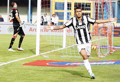 Juventus' Arturo Vidal (right) celebrates after scoring against Catania on Sunday