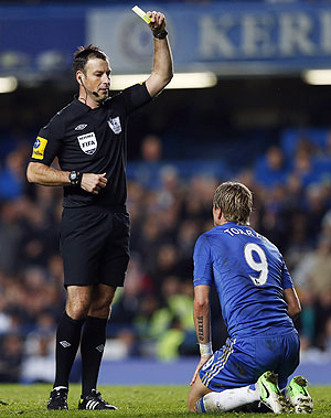 Chelsea's Fernanado Torres (right) is sent off with a second yellow card by referee Mark Clattenburg during their Premier League match on Sunday