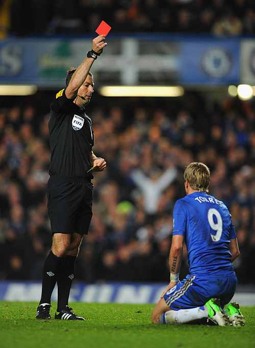 Fernando Torres of Chelsea is shown the red card by referee Mark Clattenburg during the Barclays Premier League match between Chelsea and Manchester United