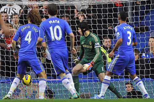 Chelsea's David Luiz scores an own goal past Peter Cech during their English Premier League match against Manchester United