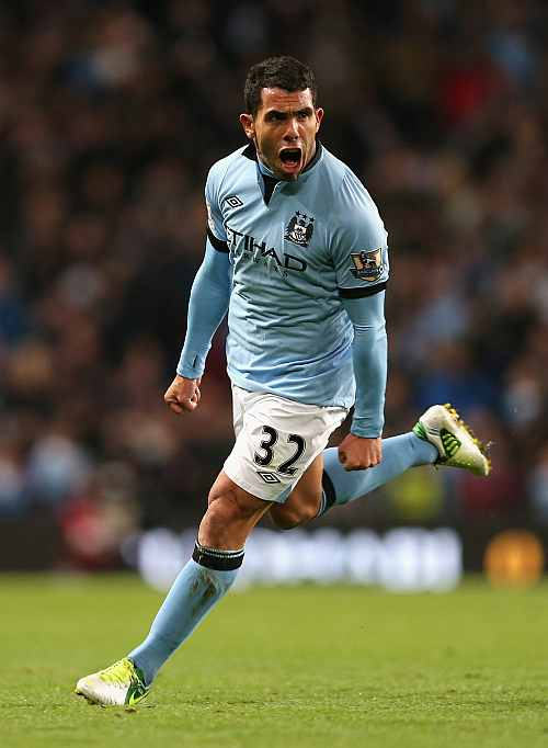 Carlos Tevez of Manchester City celebrates scoring the opening goal during the Barclays Premier League
