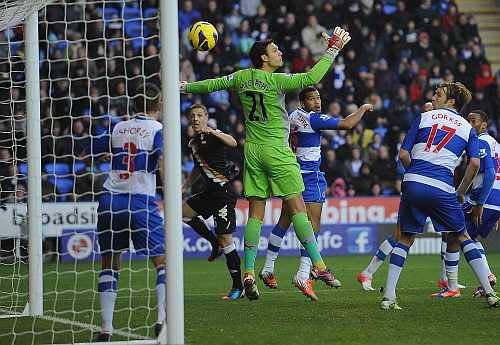 Chris Baird of Fulham watches as his header goes past goalkeeper Alex McCarthy of Reading for Fulham's second goal