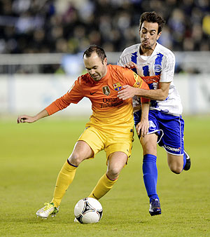Barcelona's Andres Iniesta (left) and Deportivo Alaves' Guzman Casaseca vie for possession during their Spanish King's Cup match on Tuesday