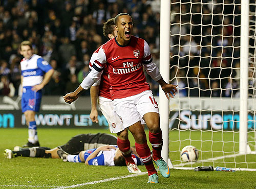 Theo Walcott of Arsenal celebrates after scoring