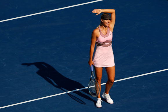 Maria Sharapova of Russia celebrates defeating Mallory Burdette of the United States in their women's singles third round match on Day Five of the US Open