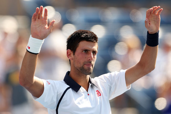 Novak Djokovic of Serbia celebrates after defeating Rogerio Dutra Silva of Brazil in their men's singles second round match