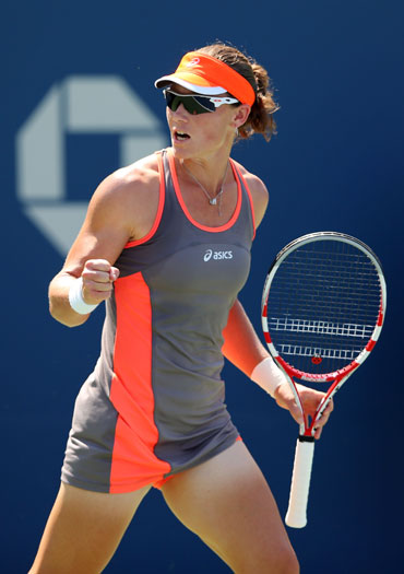 Samantha Stosur of Australia reacts after a shot against Varvara Lepchenko of the United States during their women's singles third round match