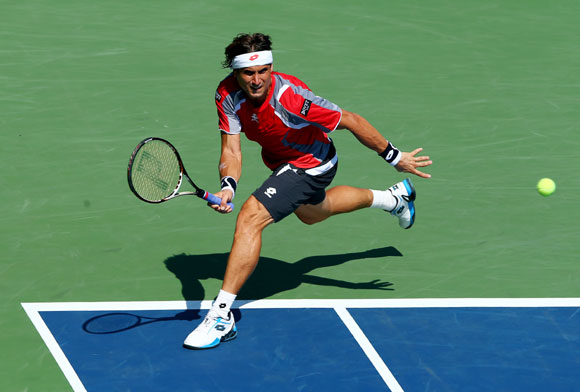 David Ferrer of Spain returns a shot against Igor Sijsling of Netherlands during their men's singles second round match