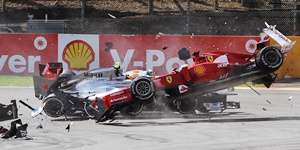 Fernando Alonso (front) of Spain and Ferrari and Lewis Hamilton