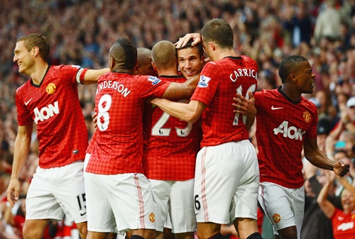 Robin van Persie of Manchester United is congratulated by his team mates