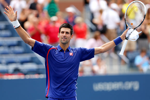Novak Djokovic of Serbia reacts after winning his men's singles third round match against Julien Benneteau of France