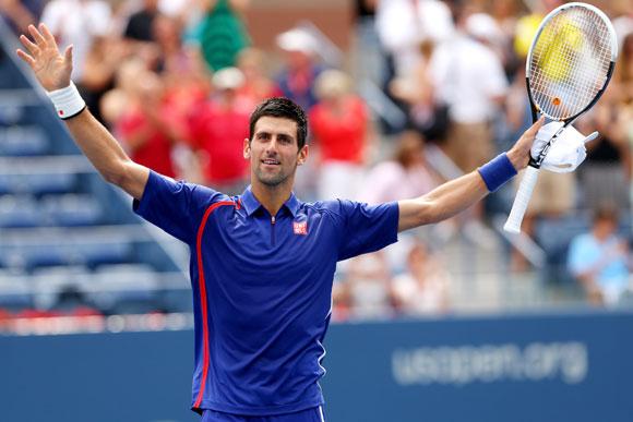 Novak Djokovic of Serbia reacts after winning his men's singles third round match against Julien Benneteau of France