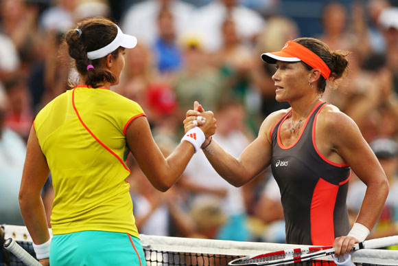 Samantha Stosur of Australia shakes hands with Laura Robson of Great Britain after their women's singles fourth round match