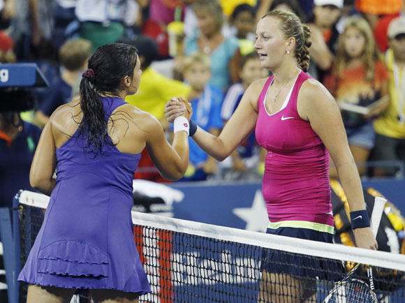 Marion Bartoli of France (L) shakes hands with Petra Kvitova of the Czech Republic after winning their match at the U.S. Open