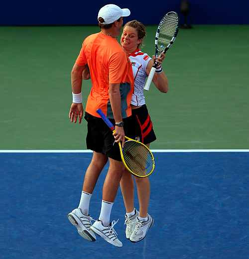 Kim Clijsters of Belgium and her partner Bob Bryan of the United States reacts after defeating Irina Falconi of the United States and Steve Johnson of the United States